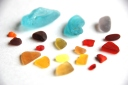 sea glass ocean beach aqua red orange yellow violet black