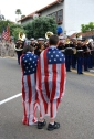 patriotic flag capes draped in flags for marine military parade welvoming troops back hom from afganistan