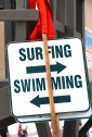 surfing swimming beach sign