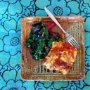 plate of food dinner lasagna and sauted swiss chard