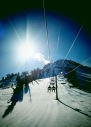 mammoth mountain chair lift sunny day of snowboarding sun snow