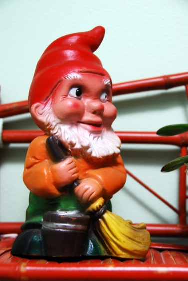 gnome with broom cleaning working sweeping california pixie