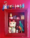 shadow box spraypainted chotchky display gumby pokey vintage nick nack collection rocky thor santa claus pez patrick