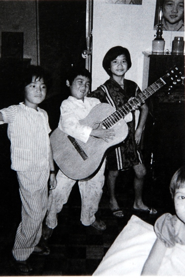 jay encarnacion playing guitar as a child filipino pinoy rock moonpools and caterpillars