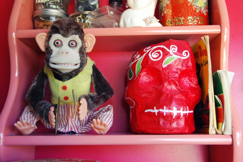 cymbal monkey dia de los muertos paper mache skull pin shelf red walls california pixie kitschy decor blog